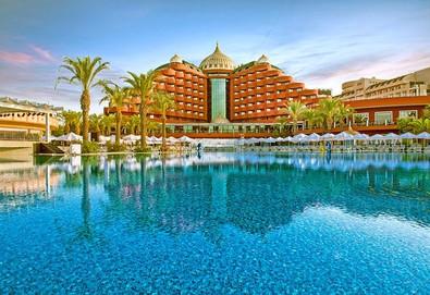 Самолетна почивка в Турция! 4 нощувки на човек на база Ultra all inclusive в Delphin Palace Hotel 5*, Лара, Турска ривиера с двупосочен чартърен полет от София - Снимка