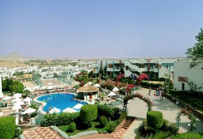 Самолетна почивка в Египет! 7 нощувки на човек на база All inclusive в Sharm Holiday Resort 4*, Шарм Ел Шейх, Червено Море с двупосочен чартърен полет от София - Снимка