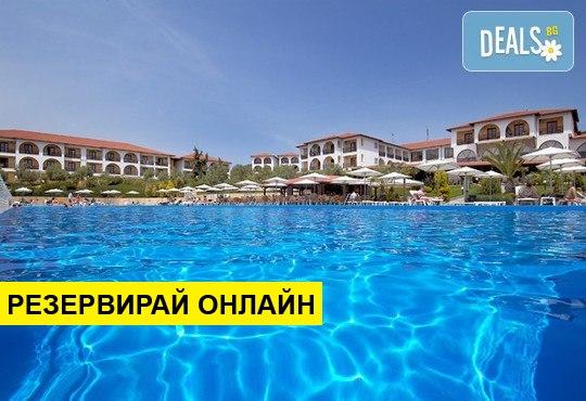 Нощувка на база AI в Akrathos Beach Hotel 4*, Уранополис, Халкидики